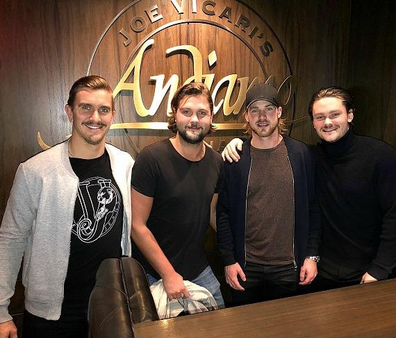 Calgary Flames players Mikael Backlund, Elias Lindholm and Rasmus Andersson with Filip Andreason at Andiamo Italian Steakhouse Las Vegas
