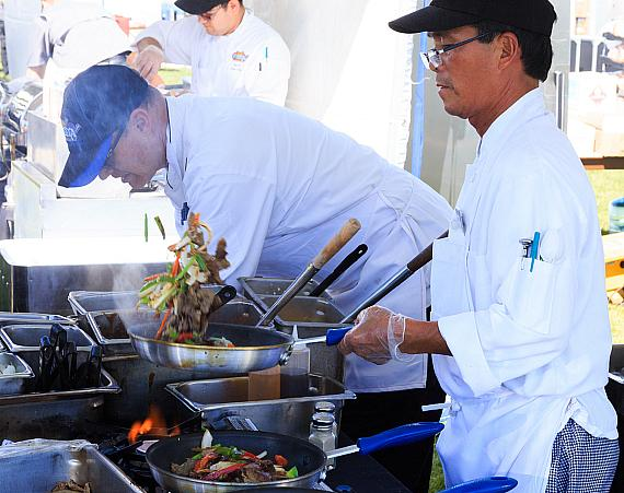 Cooks preparing delicious food at DeCadence Food Festival in Henderson