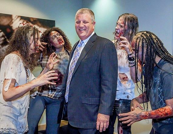 """Derek Stevens surrounded by infected from """"Fear The Walking Dead: Survival"""" at The D Casino Hotel Las Vegas"""