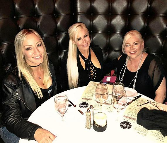 Guitarist Nita Strauss, WWE star Dana Brooke and Mother at Andiamo Italian Steakhouse in the D Casino Hotel Las Vegas