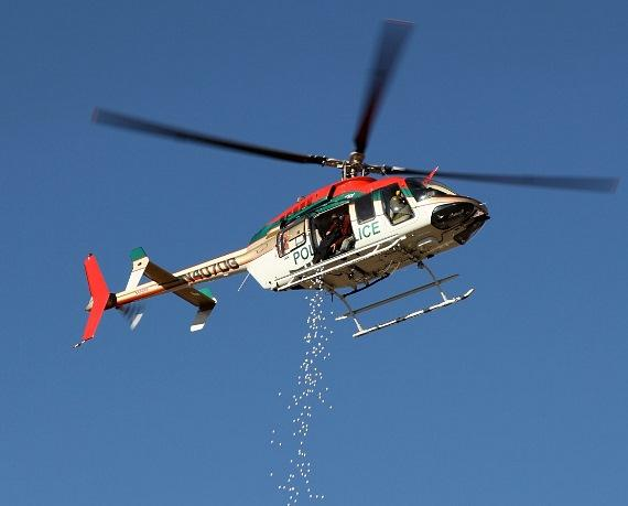 """""""Golf Balls from Heaven"""" - a Metro helicopter dropped 1300 pre-numbered and pre-sold golf balls up over the driving range"""