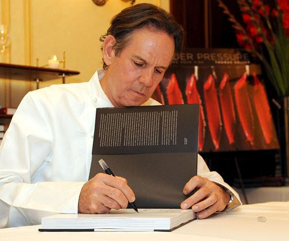 """Chef Thomas Keller signing a copy of his latest cookbook, """"Under Pressure"""" (Artisan Books)"""