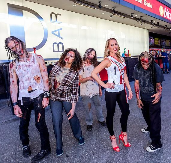 """The D Casino's """"Miss D Legs"""" runner up Ruthie with infected from """"Fear The Walking Dead: Survival"""" on Fremont Street Experience Las Vegas"""