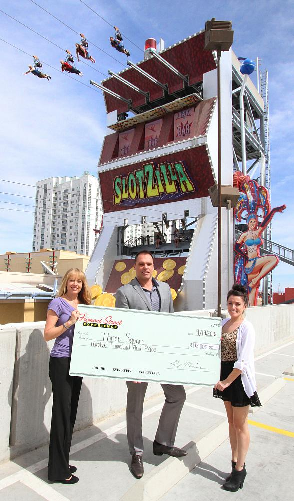 Fremont Street Experience Presents Three Square Food Bank a Check for $12,000 Raised from SlotZilla Charity Challenge