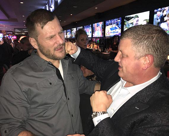 """UFC Heavyweight Stipe Miocic with the D Las Vegas owner Derek Stevens """"throwing a punch"""" while at The Longbar inside the D Las Vegas"""