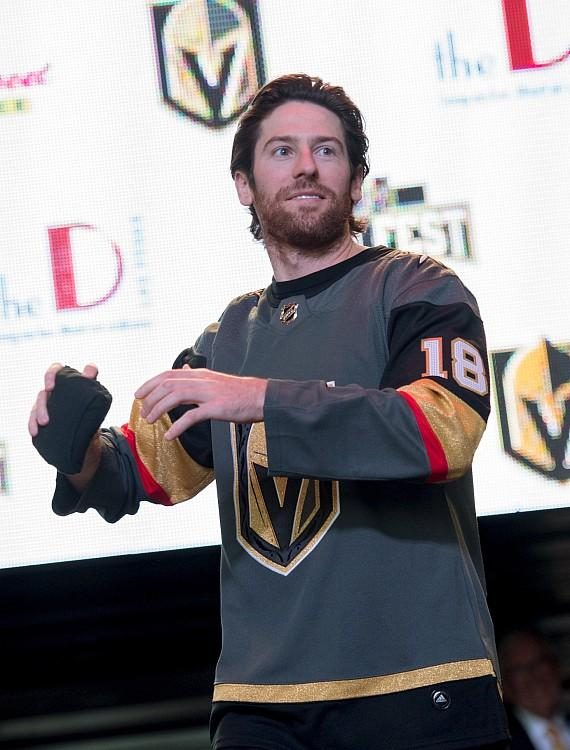 Vegas Golden Knights James Neal throws shirts into the crowd at Fan Fest on Fremont Street