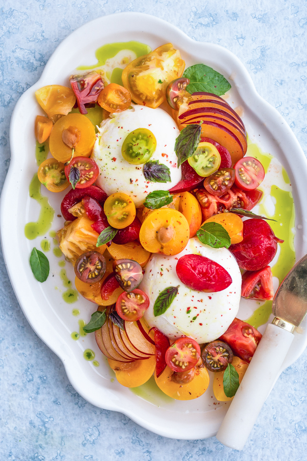 Burrata with Plums Tomatoes and Mint-Basil Oil Recipe
