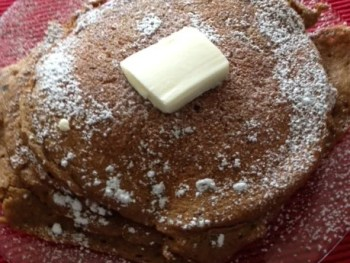 image of gingerbread pancakes with butter and powdered sugar