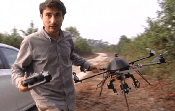 mark-devries-carrying-drone-to-location-592x378
