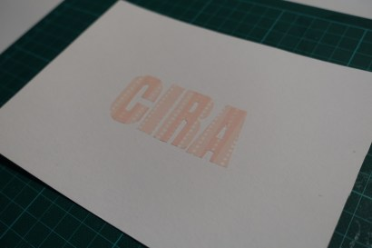 Glued letters on paper