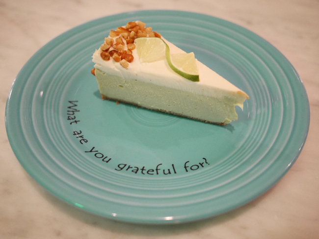 Key Lime Pie. Creamy avocado-lime custard topped with coconut meringue in a pecan-macadamia date crust.