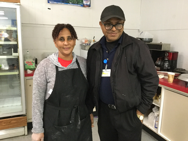 Chef, Tirhas Negassi Woldebabr and Manager, Mehari. T. Ocbamichael, owners of Family Convenient Store