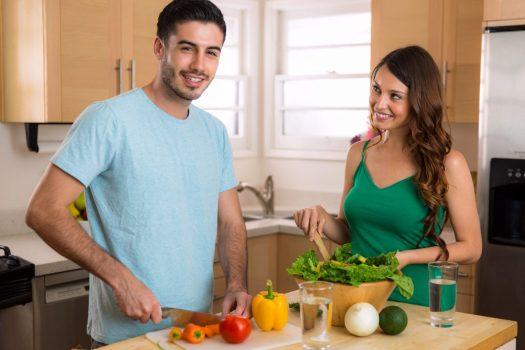 Couple Prepare Vegetables