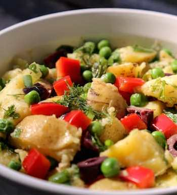Herbed potato salad with green peas