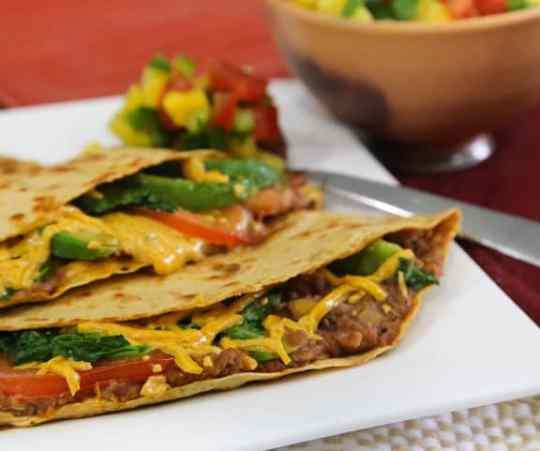 Big quesadillas with refried beans and spinach