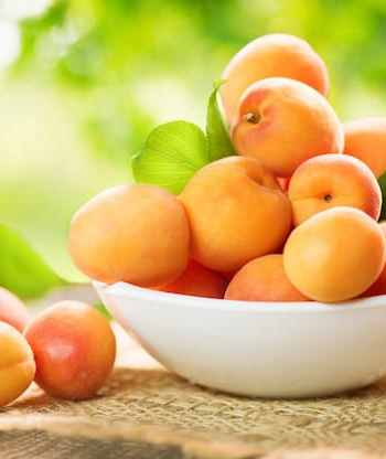 Apricots on table