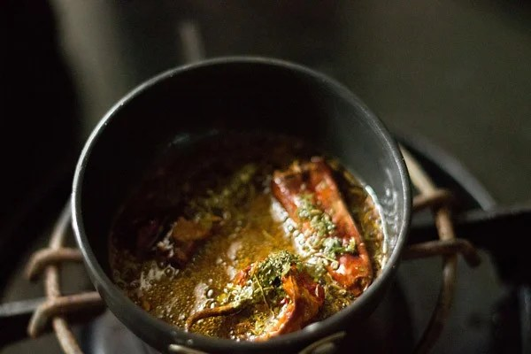 dry fenugreek leaves and red chilli powder added in the pan