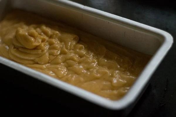 orange cake batter in baking tin