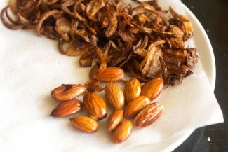 fried almonds on paper towel to drain