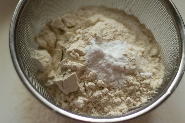 whole wheat flour and baking powder in a sieve