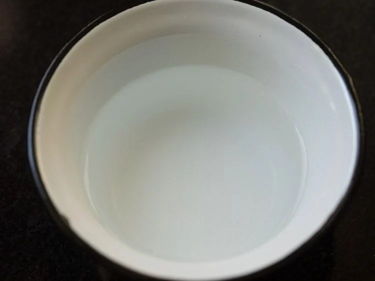 pour the warm water into a medium bowl.