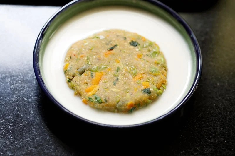 one vegetable cutlet patty dipped in the flour slurry