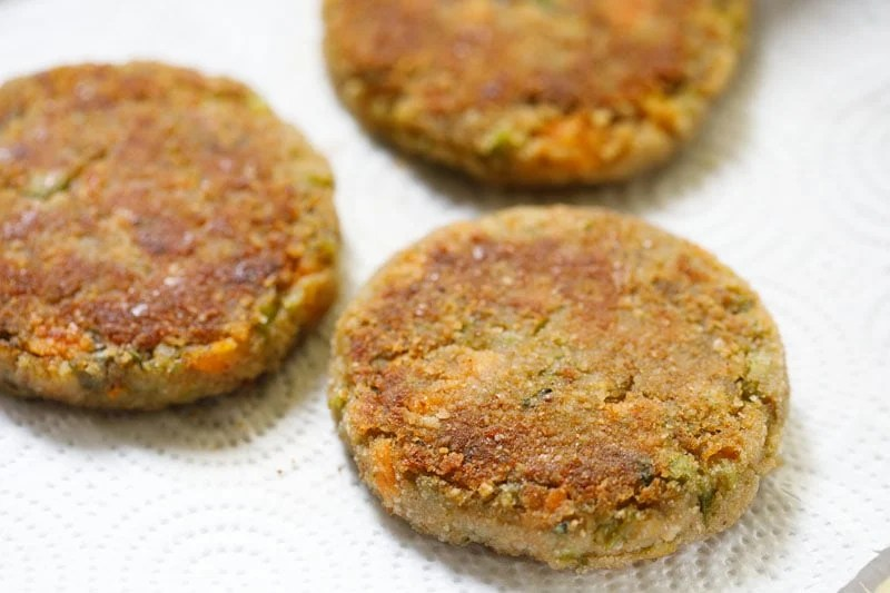 pan fried cutlets placed on kitchen paper towels