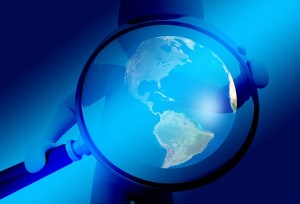 Magnifying glass earth globe