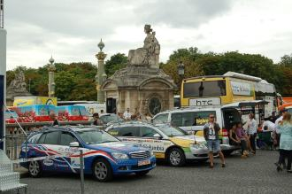 Team cars prepare for the journey - many of the buses however won't go to Paris.