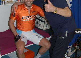 Tristan after the flying lap, Michelle the soigneur shares the glory.
