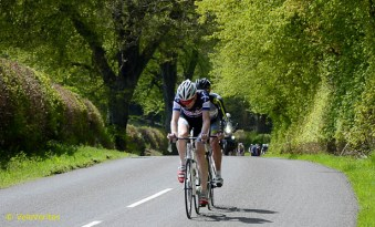 Lap 5: Arthur Doyle (Dooleys) and David Lines (PedalPower) give it a dig and take 10 seconds on the bunch.