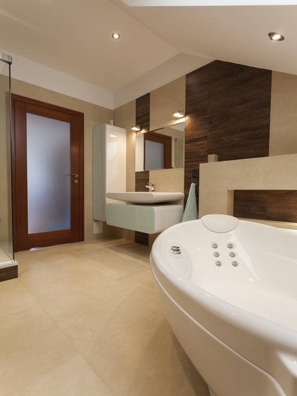 combination of wood look alike tile and cream tile for bathroom