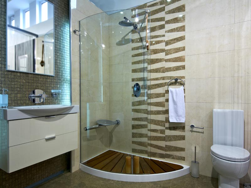 light brown tile for floor and walls with light brown mosaic