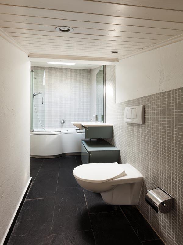 matt black tile used on the bathroom floor