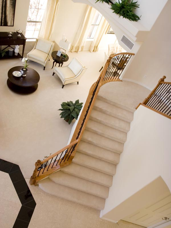 matt light cream and polished black tile on floor and staircase