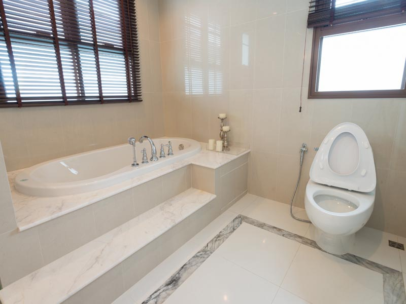 polished white tiles for bathroom floor and bianco Carara used on the step