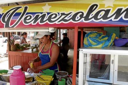 Venezolanos en el exterior, los profesionales de las arepas