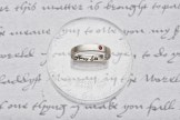 "ring BOLEYN, (from the letter of Anne Boleyn to Cardinal Wolsey, 1528, ""my hearty love"", black diamond ruby engraving on silver"