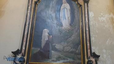 Il restauro della tela della Madonna di Lourdes in San Lorenzo a Vercelli