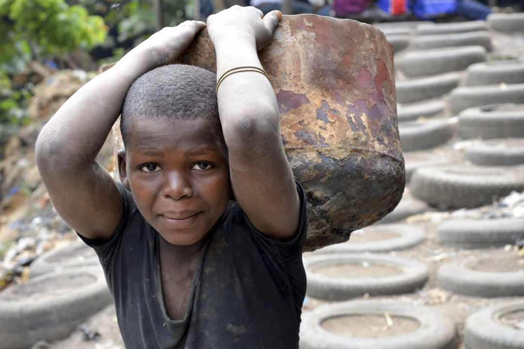 CNBC Article - Boy carries bucket
