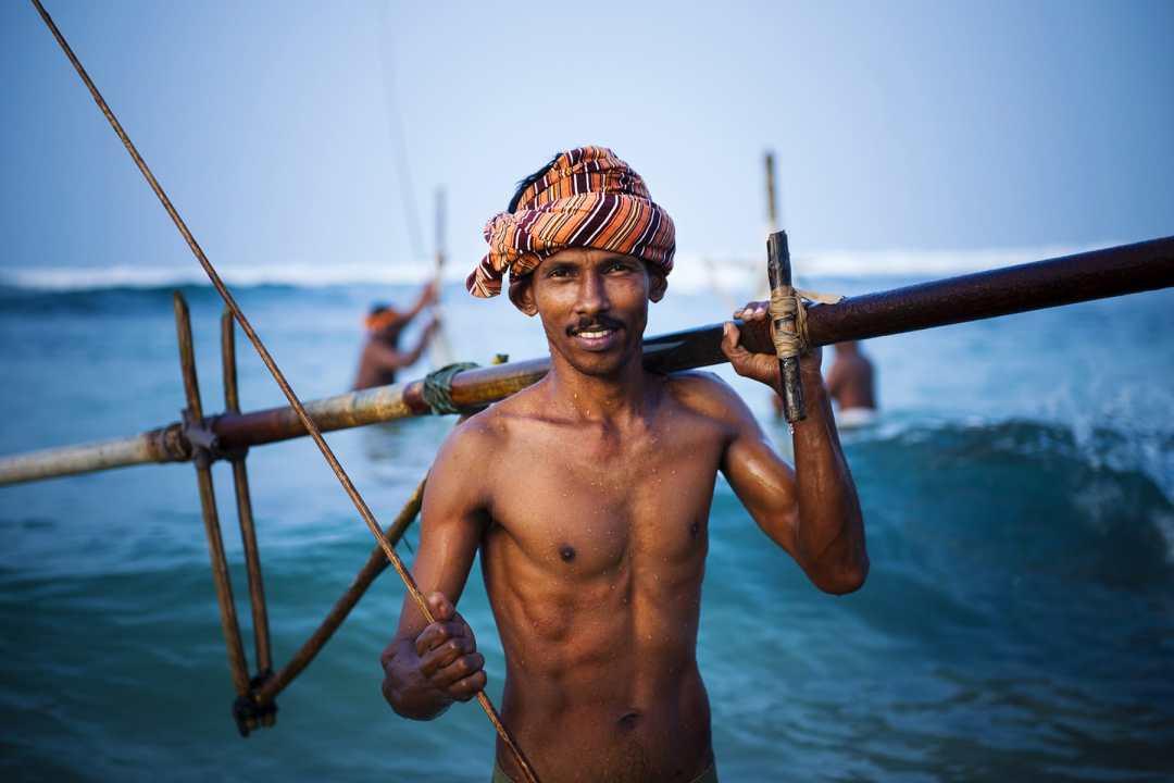 fisherman looking at camera