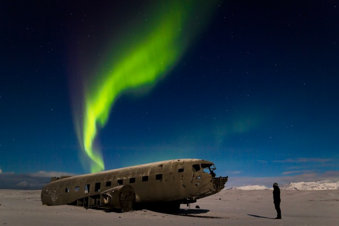 Northern lights at the aeroplane crash site Iceland