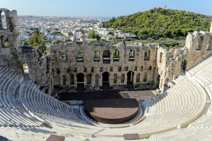 Odeon of Herodes Atticus - Athens, Greece, Europe - Honeymoon Part 1 - Athens is a beautiful capital city rich with history. With it's impressive Acropolis and quaint pedestrian streets, we headed here for our Honeymoon Part 1! Veritru Travel Blog