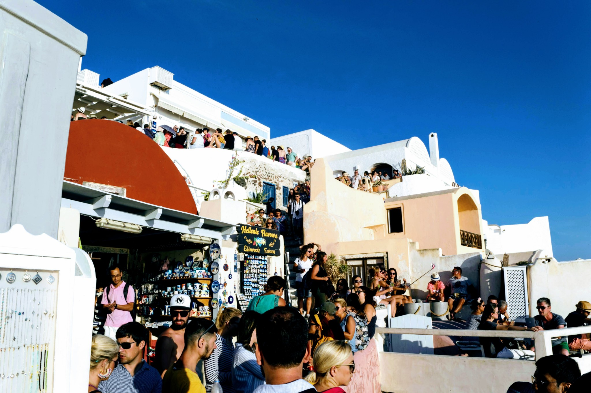 Oia sunset queue - Santorini, Greece - Honeymoon Part 2 - Oia in Santorini Greece is beautiful with its pretty caldera view, sunsets, windmills and quaint pedestrian streets, we headed here for our Honeymoon Part 2! - Greek Island, Europe - Veritru