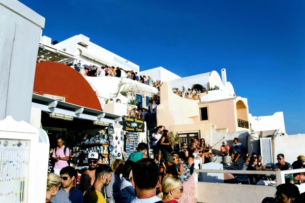 7 Things No One Tells You About Santorini - Oia sunset queue - Santorini, Greece - Honeymoon Part 2 - Oia in Santorini Greece is beautiful with its pretty caldera view, sunsets, windmills and quaint pedestrian streets, we headed here for our Honeymoon Part 2! - Greek Island, Europe - Veritru