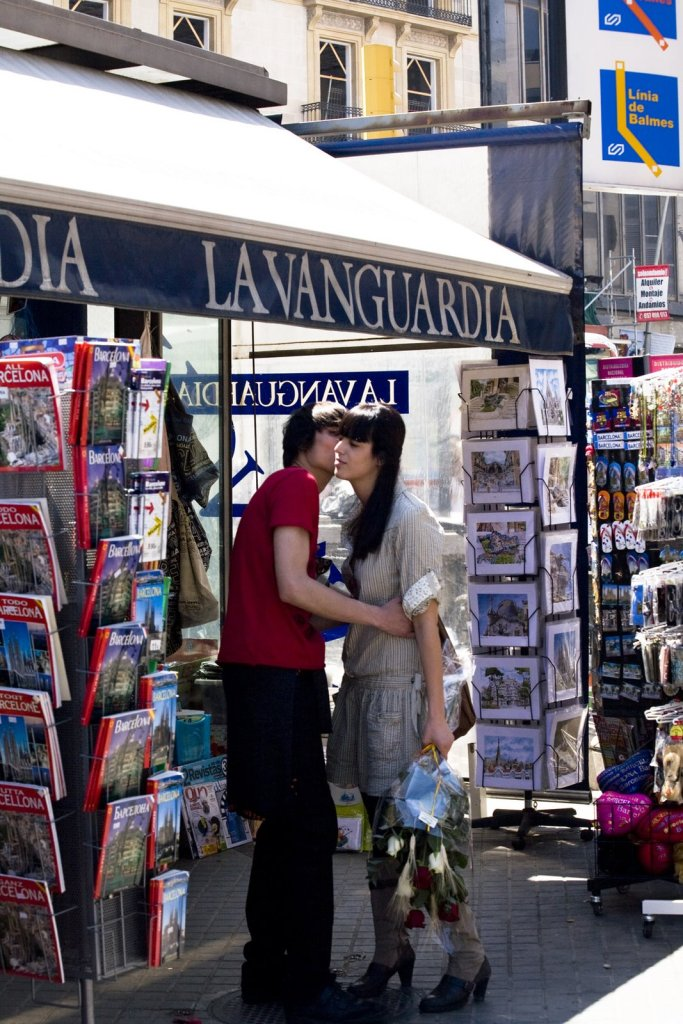 Young couple kissing each other under a kiosk