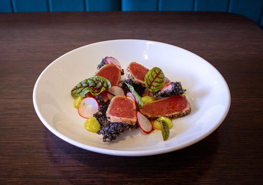 Morell Seared tuna sashimi, wasabi mayo, burnt chilli dressing and crispy squid ink tapioca wafers