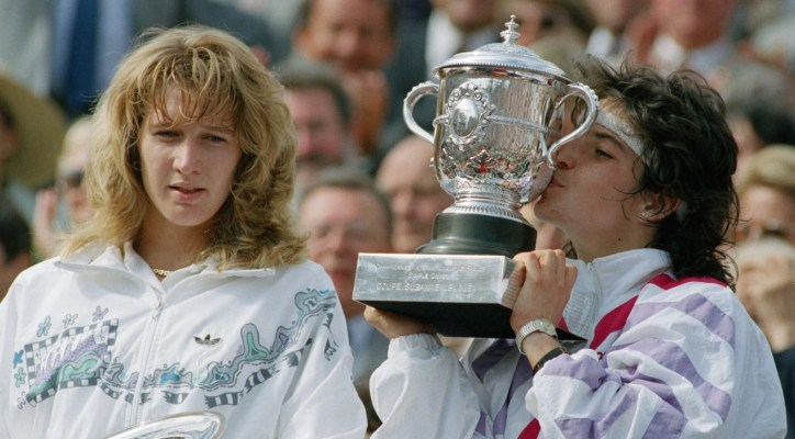 Arantxa Sanchez Vicario kisses her trophy after defeating Steffi Graf at the French Open in 1989