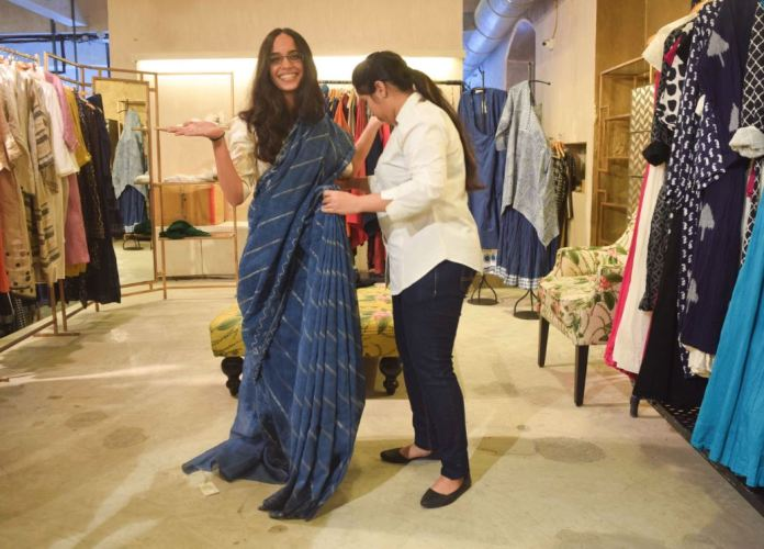 Tina paired a Good Earth Sustain sari with a blouse from Raw Mango