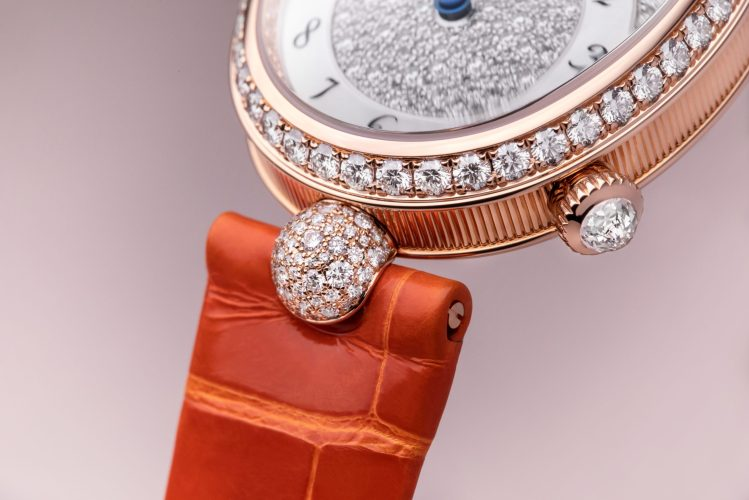 Breguet Reine De Naples 8938, in rose gold with an orange bracelet